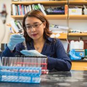 Yi Wen working in lab